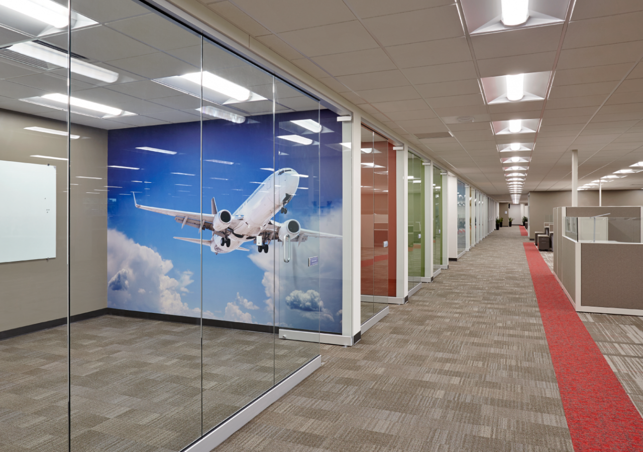 Office Space with Airplane Mural at BAE Systems Manufacturing Facility Built by ARCO Construction