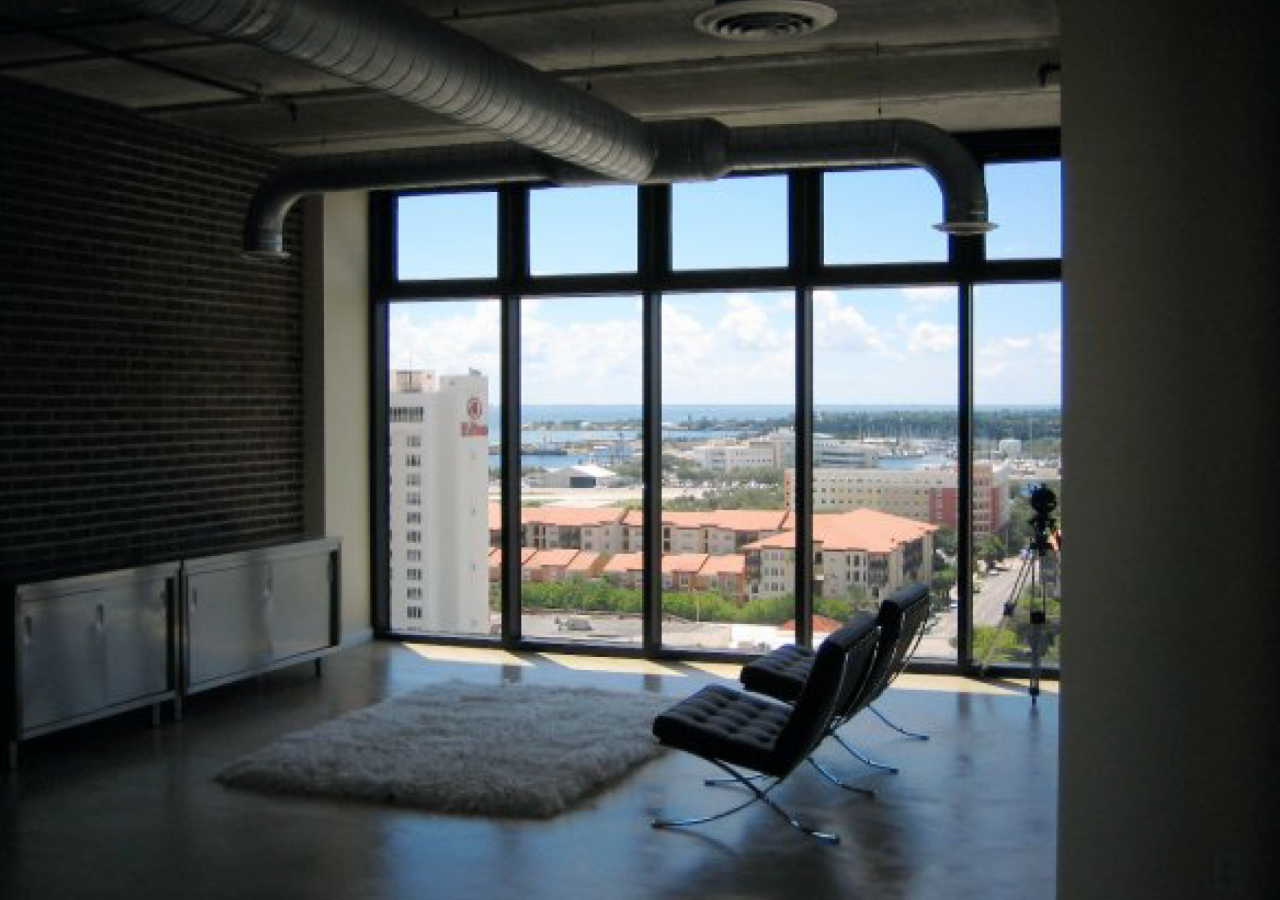Living Space with Large Windows and View at McNulty Lofts Multifamily Facility Built by ARCO Construction